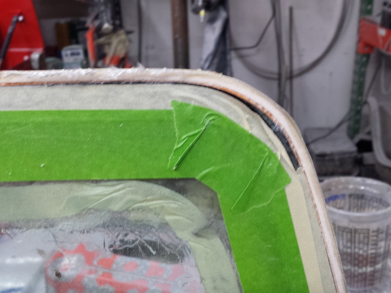 Build a small, nearly flush windshield frame whose edge will barely be visible